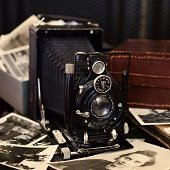 antique camera and photos