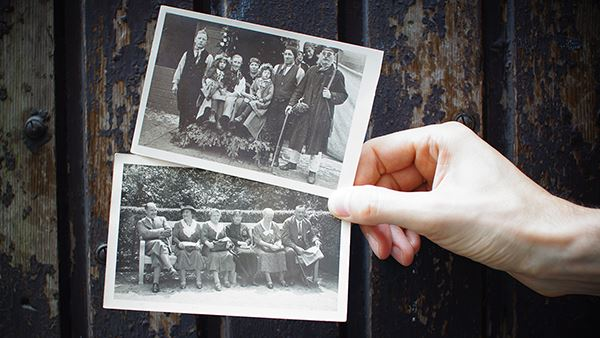two black and white family photos held up
