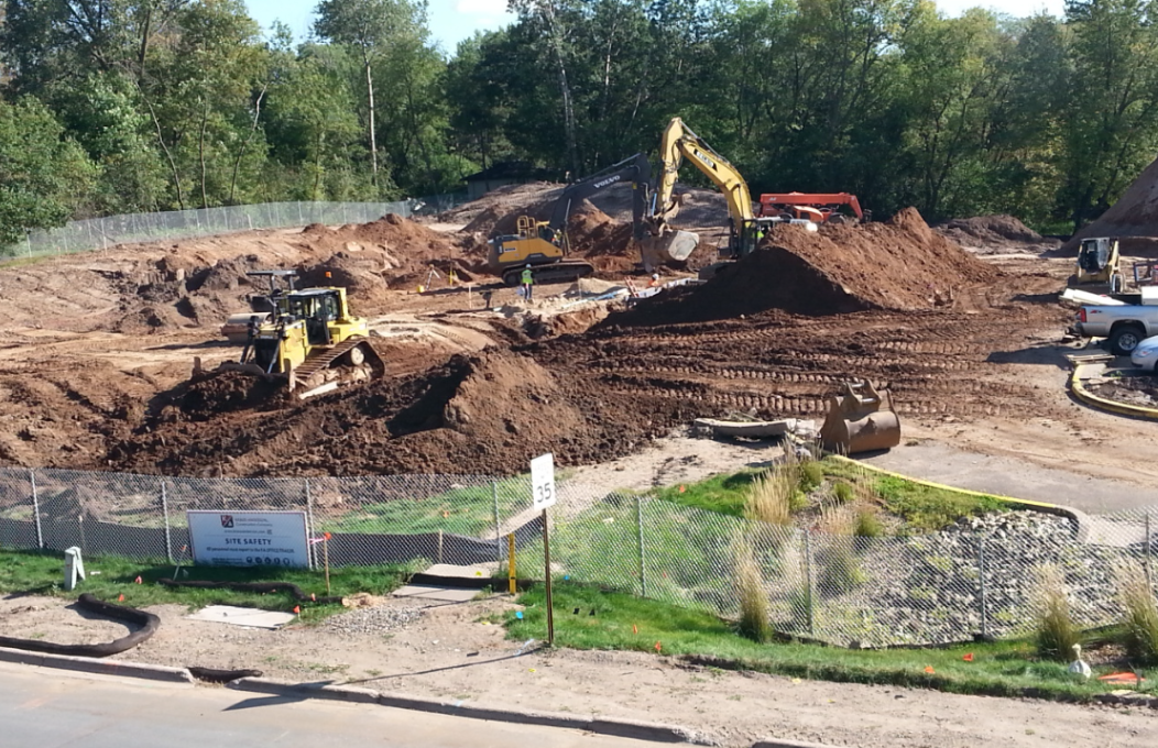 Image of construction crews installing footings and utility lines for the new Library.