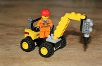 Lego figure driving a construction vehicle.jpg